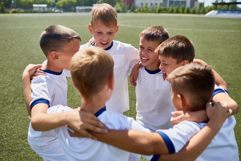 Junior Football Team Embracing